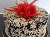 Black, red & gold celebration cake