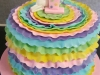 Rainbow coloured ruffle cake with unicorn