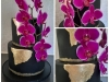 Wedding cake in black with gold & purple