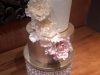 Wedding cake in cream, gold & touch of pink