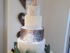 Wedding cake with edible lace, buttercream icing, pettinice decor & fairy lights